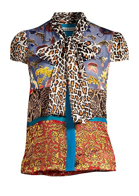 """Image of Bold florals and leopard prints adorn effervescent chiffon blouse in patchwork formation. Tie-neck. Cap sleeves. Concealed button front. Viscose/silk/polyester/elastane. Dry clean. Imported. SIZE & FIT. About 23"""" from shoulder to hem. Model shown is 5'10"""""""