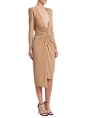 Image of Cut to flatter your form, this elegant knotted bodycon dress is crafted from stretch jersey. Structured shoulders and a plunging neckline add romance and sensuality to the piece. Deep V-back Long sleeves Pullover style Knotted bodice Asymmetric step hem L