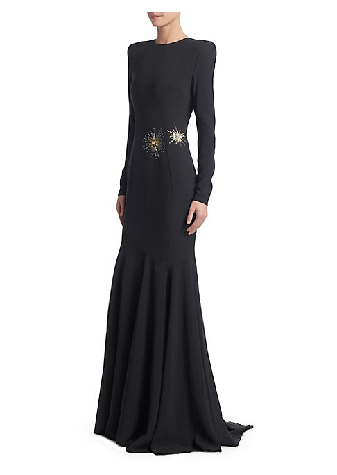 Image of Effortlessly elegant, this fitted gown falls to an asymmetric flowy hem and flaunts structured shoulders. Its sleek tailored finish is updated with glamorous bursts of beading for an eye-catching twist. Roundneck. Long sleeves. Concealed back zip. Structu