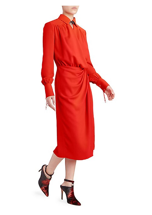 """Image of A harness-trimmed neckline, lace-up cuffs, and O-ring hardware bring edge to an otherwise classic wrap silhouette. Spread collar with harness detail. Long sleeves. Lace-up cuffs. Wrapped waist. Polyester. Dry clean. Made in Italy. SIZE & FIT. About 54"""" fr"""