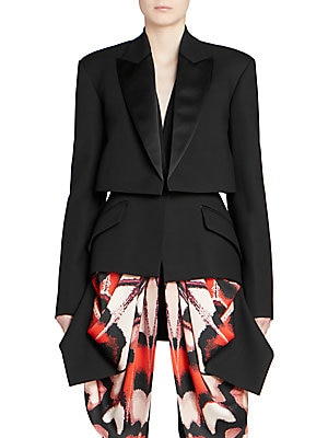 Image of From the Saks IT LIST SUIT YOURSELF The new suit: equal parts precision tailoring and feminine fit. Designer Sarah Burton slices and dices the tuxedo jacket, putting her own spin on it. A boxy upper jacket sits atop a more fitted one, with scarf-like pane