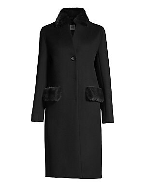"""Image of Mid-length coat cut from wool-blend features luxe mink fur trim at collar and pockets Stand collar Long sleeves Button front Side flap pockets About 42"""" from shoulder to hem Virgin wool/cashmere Fur type: Dyed mink Fur origin: Finland Dry clean by fur spe"""