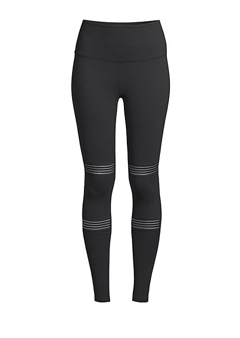 """Image of Eye-catching on-trend cut out details enhance these solid stretch tights. Elasticized waist. Pull-on style. Cut out details above and below knees. Rise, about 10"""".Inseam, about 27.5"""".Nylon/spandex. Machine wash. Imported. Model shown is 5'10"""" (177cm) wear"""