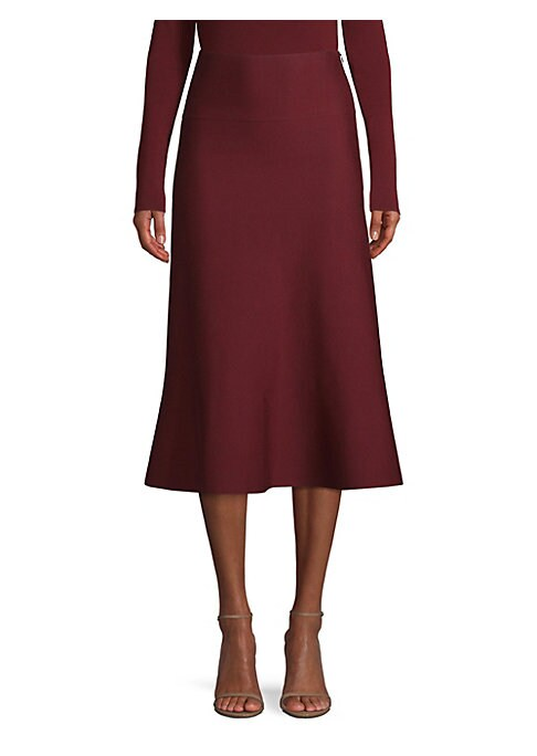 Image of Boasting a fluted shape that hits the wearer below the knee, this minimalist skirt is a highly wearable piece. It's crafted out of Italian wool spliced with some stretch for a comfortable fit. Banded waist. Concealed side zip closure. Wool/polyamide/elast