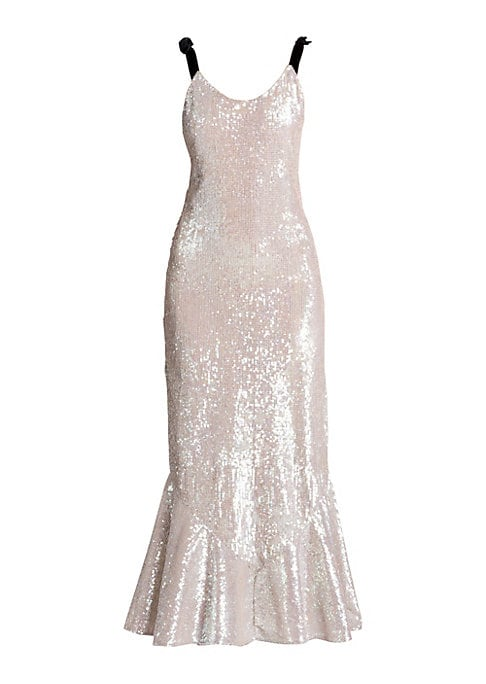 Image of From the Saks IT LIST. SILVER. Shine bright in the season's new neutral. Sumptuous sequins adorn this figure-hugging maxi that falls to a flattering flutter hem. Finished with feminine velvet bow straps, it's the perfect simple slip to make a statement wi