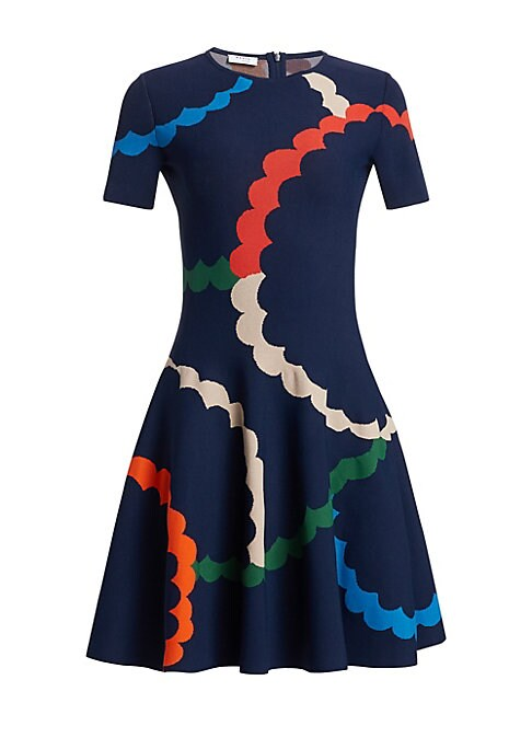 Image of Fun and flirty party dress with a nipped waist bell-shape silhouette is a ladylike staple. The sculptural quality of this piece is offset by a whimsical scallop print for a playful feel. Banded roundneck. Short sleeves. Concealed back zip. Nipped waist. V