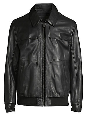 """Image of Sleek collared leather jacket with a bomber look. Spread collar Long sleeves Front zip close Side slip pockets Rib-knit hem Lined Leather Trim: acrylic/wool Professional leather clean Imported SIZE & FIT Regular fit About 27"""" from shoulder to hem. Men Lux"""