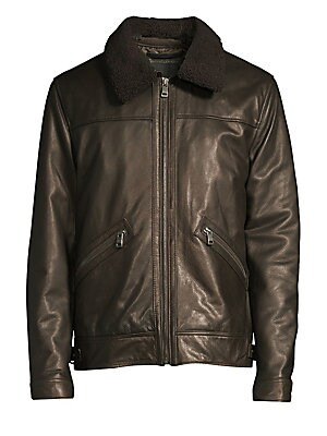 Image of Metallic leather jacket is crafted with a bold shearling collar. Shearling spread collar Long sleeves Snap tab-button cuffs Zip front Waist zip pockets Tab snap-button hem Fully lined Leather Fill: Polyester Fur type: Dyed lamb shearling Fur origin: Turke