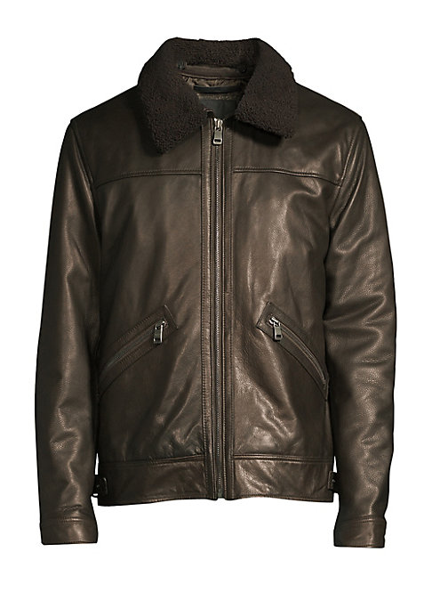 Image of Metallic leather jacket is crafted with a bold shearling collar. Shearling spread collar. Long sleeves. Snap tab-button cuffs. Zip front. Waist zip pockets. Tab snap-button hem. Fully lined. Leather. Fill: Polyester. Fur type: Dyed lamb shearling. Fur ori