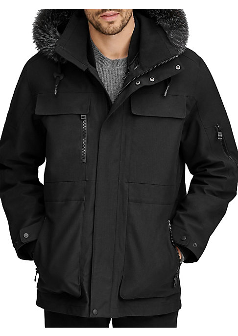 Image of Sleek technical jacket boasts a 3-in-1 down quilted lining and water resistant finish. Removable fur-trimmed drawstring hood. Stand collar. Long sleeves. Front zip close with covered button front. Chest button flap pockets. Chest zip pocket. Waist zip poc