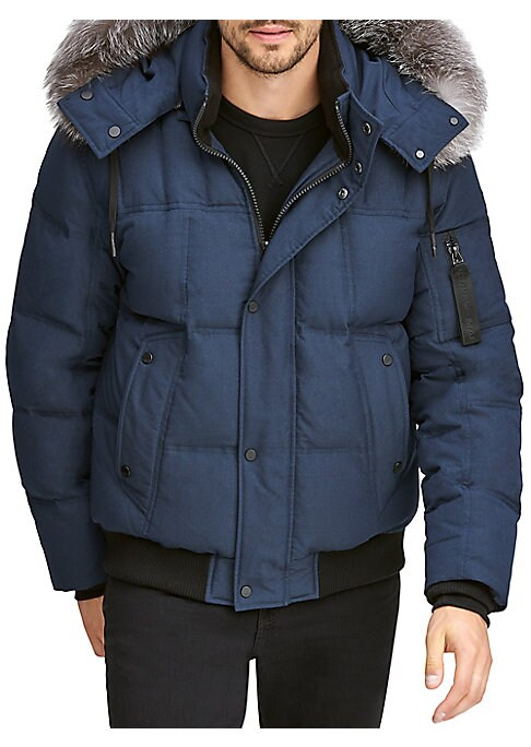 Image of Warm down filled quilted bomber trimmed with a luxe fox fur hood. Removable drawstring fur-trimmed hood. Stand collar. Long sleeves. Front zip with covered snap button placket. Side button flap pockets. Arm zip pocket. Rib knit hem and cuffs. Lined. Polye
