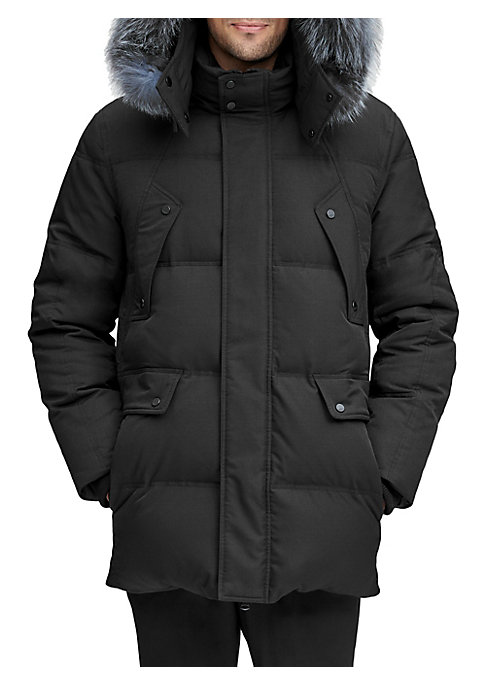 Image of Warm down filled quilted parka trimmed with a luxe fox fur hood. Removable drawstring fur-trimmed hood. Stand collar. Long sleeves. Front zip with covered snap button placket. Chest button flap pockets. Waist button flap pockets. Side slip pockets. Rib kn