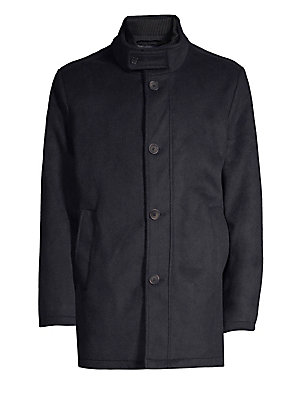 """Image of This stretch wool waterproof coat features an attached quilted inner coat. Button Stand lapels Long sleeves Quilted zip-up inner coat Front button closure Slip pockets at waist Polyester/wool Dry clean Imported SIZE & FIT Regular fit About 33"""" from should"""