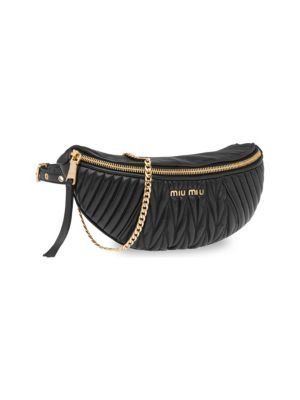 fa3b622adde9 Fashion-forward bum bag in quilted leather with goldtone logo. Chain strap.  Zip top. Buckled waist closure. Goldtone hardware 24