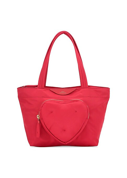 """Image of Cute heart-shaped pocket elevates this minimalist carry-on. Top zip closure. Goldtone hardware. One exterior front zip pocket. One interior slip pocket. Fully lined. Nylon. Imported. SIZE. Double top handles, 3.15"""" drop.9.25""""W x 5.12""""H x 3.54""""D."""