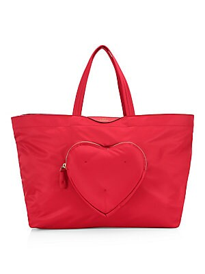 """Image of Durable tote is crafted with a spacious interior and an adorable chubby heart-shaped pocket. Top zip closure Goldtone hardware One exterior front heart-shaped zip pocket Two interior slip pockets Fully lined Nylon Imported SIZE Double top handles, 8"""" drop"""