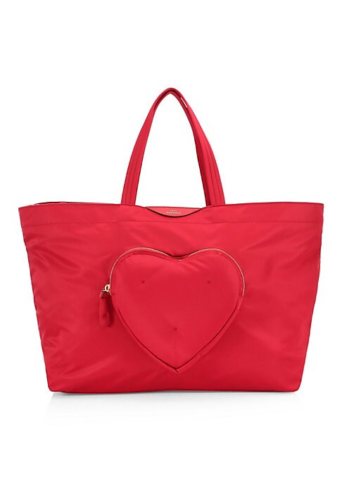Image of Durable tote is crafted with a spacious interior and an adorable chubby heart-shaped pocket. Top zip closure. Goldtone hardware. One exterior front heart-shaped zip pocket. Two interior slip pockets. Fully lined. Nylon. Imported. SIZE. Double top handles,