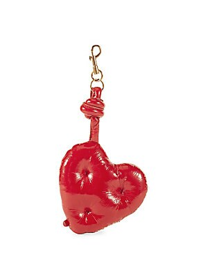 Image of From the Saks IT LIST HIGH GLOSS Edgy meets glam in fall's uber-polished materials. High-shine heart charm with plush quilted detail Patent leather Lobster clasp 19cm H x 11.3cm W x 3cm D Imported. Handbags - Advanced Designer Handba. Anya Hindmarch. Colo