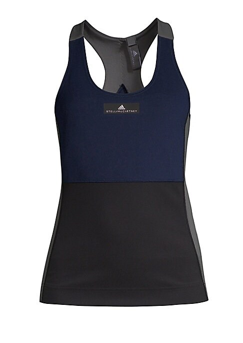 """Image of Comfortable stretch tank crafted from environmentally responsible polyester. Scoopneck. Sleeveless. Abut 24.5"""" from shoulder to hem. Recycled polyester/spandex. Machine wash. Imported. Model shown is 5'10"""" (177cm) wearing US size Small."""
