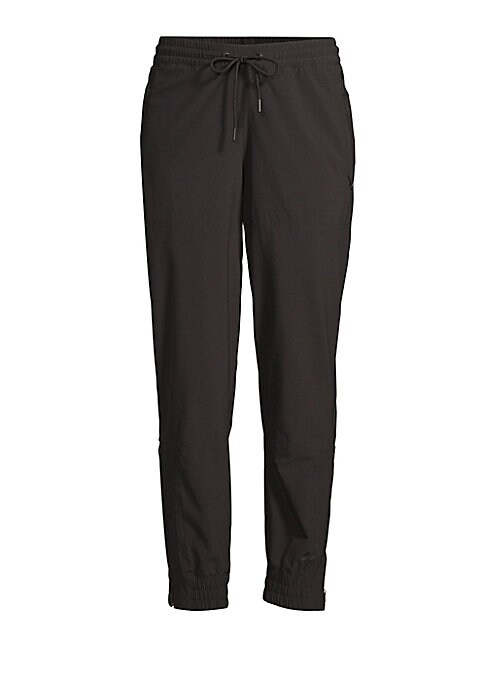 """Image of Cuffed sweatpants with ruched zip ankles. Drawstring waist. One zip pocket. Rise, 10"""".Inseam, 26"""".Leg opening, 10"""".Nylon/spandex. Machine wash. Imported. Model shown is 5'10"""" (177cm) wearing US size Small."""