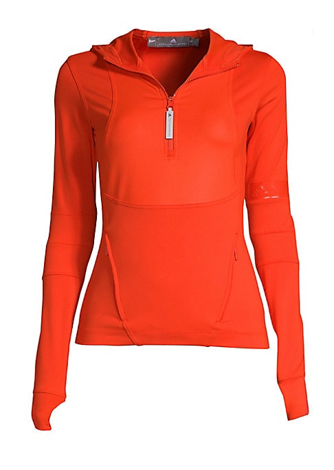 """Image of Fitted pullover with thumbholes and translucent logo at the arm. Attached hood. Long sleeves. Quarter zip placket. Two zip pockets. Reflective details. About 23"""" from shoulder to hem. Recycled polyamide/spandex. Machine wash. Imported. Model shown is 5'10"""