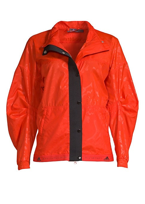 """Image of Belted wind jacket with logo hem and tonal pattern. Stand collar. Long sleeves. Ribbed cuffs. Zip closure. Snap-button storm flap. Waist belt. Two pockets. Gathered back. About 24.5"""" from shoulder to hem. Recycled polyester. Machine wash. Imported. Model"""
