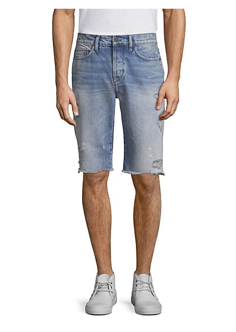 """Image of Beach-style jean shorts in a fade wash with distress details. Button and zip-fly closure. Five-pocket style. Back patch logo detail. Rise, about 11"""".Inseam, about 12"""".Leg opening, 18.5"""".Cotton. Machine wash. Imported."""