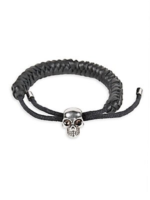 Image of Adjustable braided leather bracelet with silvertone skull charm Corded leather/brass Made in Italy. Men Accessories - Leather Goods. Alexander McQueen. Color: Black Silver.