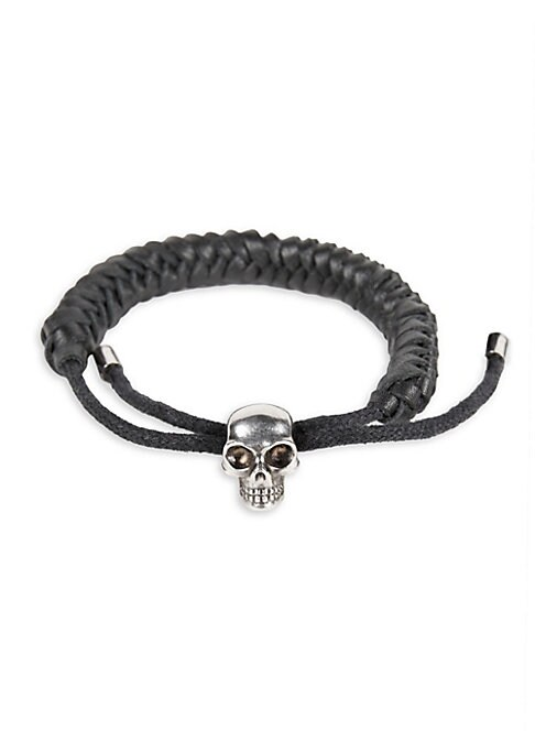 Image of Adjustable braided leather bracelet with silvertone skull charm. Corded leather/brass. Made in Italy.