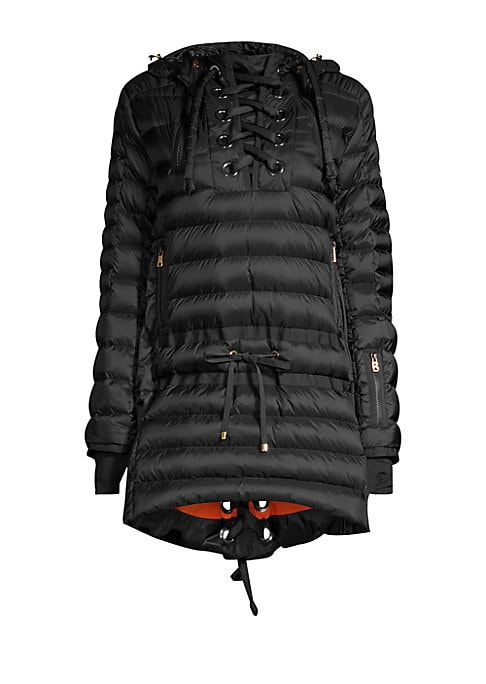 Image of Cozy down jacket with feminine lattice details. Attached hood with fur trim. Lattice neckline with dual zips. Long sleeves. Ribbed cuffs with thumb holes. Pullover style. Drawstring waist. Side zip pockets. Zipped side vents. Lattice back detail. Fishtail