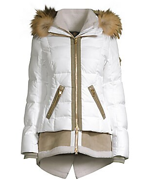"""Image of Cozy lamb shearling coat in a quilted design Stand collar Attached hood Long sleeves Ribbed cuffs Sleeve zip pocket Double zip front Waist zip pockets Back vent About 26"""" from shoulder to hem Polyester/polyurethane Fur type: Dyed lamb Fur origin: Spain Fu"""