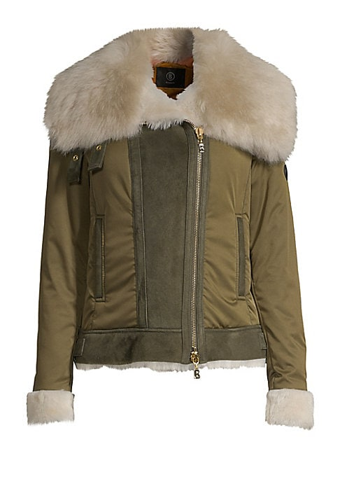 """Image of Plush fur trim lends glamour to this sleek sporty jacket. Fur spread collar. Long sleeves. Fur cuffs. Asymmetric zip front. Waist welt pockets. Fur hem. Polyester. Fur type: Natural lamb skin. Fur origin: Spain. Dry clean. Imported. SIZE & FIT. About 22"""""""