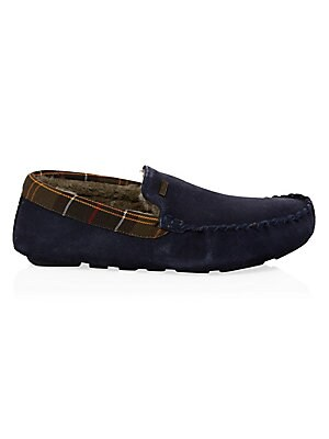 Image of A moccasin faux shearling lined slipper with a classic tartan trim collar. Suede/textile upper Slip-on style Round toe Textile lining Rubber sole Fur type: Faux Clean with suede brush Imported. Men Luxury Coll - Seasonal Classifications. Barbour. Color: B