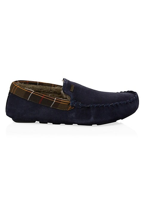 Image of A moccasin faux shearling lined slipper with a classic tartan trim collar. Suede/textile upper. Slip-on style. Round toe. Textile lining. Rubber sole. Fur type: Faux. Clean with suede brush. Imported.