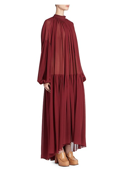 Image of A signature Stella McCartney runway style, this sheer silk georgette dress falls gently in a flowy silhouette that moves beautifully when you walk. With allover figure-flattering pleats that elongate your shape, simple accessories work best. Mockneck. Dro