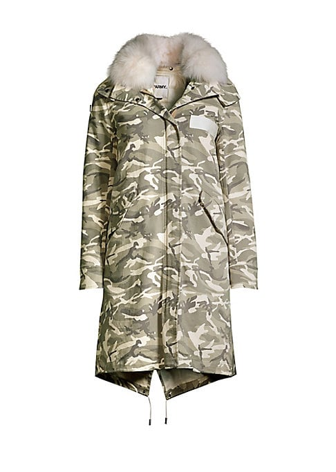 Image of Camouflage printed jacket detailed with luxe fox fur trim. Attached hood with fox fur trim. Long sleeves. Front flap pockets. Zip-front with snap button closure. Cotton. Fur type: Natural fox. Fur origin: Finland. Dry clean by fur specialist. Made in Fran