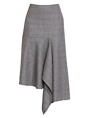 Image of From the Saks IT LIST SUIT YOURSELF The new suit: equal parts precision tailoring and feminine fit. Expertly draped to an asymmetrical silhouette, this skirt menswear-inspired skirt is patterned with handsome Prince of Wales checks. Concealed back zip clo