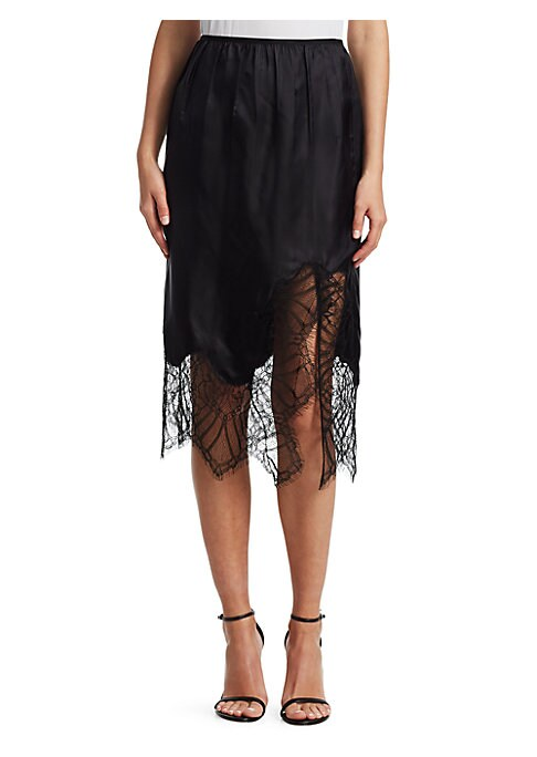 """Image of Asymmetrical slip skirt with elegant lace trim. Elasticized waistband. Pull-on style. Side slit. About 25"""" long. Viscose. Dry clean. Imported of Italian fabric. Model shown is 5'10"""" (177cm) wearing US size 4."""