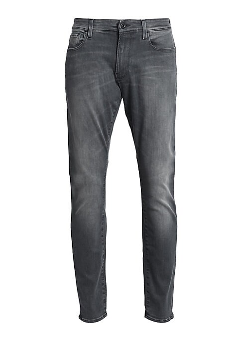 """Image of Modern slim fit jean with a classic wash. Five pocket styling. Rise, about 10"""".Leg-opening, about 12"""".Inseam, about 40"""".Cotton. Machine wash. Imported."""
