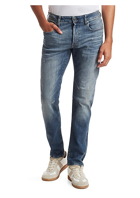 "Image of Slim fit jean with lightly distressed details. Five pocket styling. Button fly. Rise, about 10"".Leg-opening, about 12"".Inseam, about 40"".Cotton. Machine wash. Imported."
