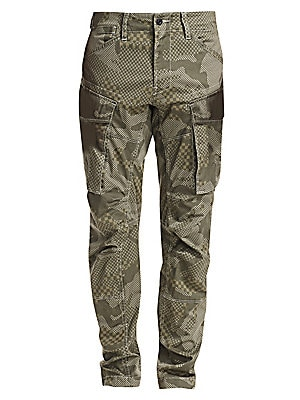 "Image of From the Saks IT LIST UTILITY Give off-duty style an on-duty function with the latest military-inspired pieces. Graphic cargo pant with a layered camo and check print Five pocket styling Zip fly Leg patch pockets Rise, about 10"" Leg-opening, about 14"" Ins"