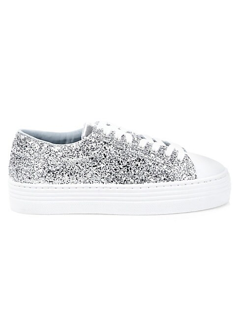 """Image of From the Saks IT LIST. SILVER. Shine bright in the season's new neutral. Reach new heights in these shimmering platform sneakers. Glitter leather upper. Round toe. Lace-up vamp. Leather lining. Rubber sole. Made in Italy. SIZE. Platform, 1.25""""."""