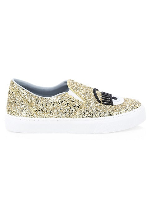Image of Eclectic eye embroidery lends pop art effects to bold shimmery sneakers. Glitter leather upper. Round toe. Slip-on style. Leather lining. Rubber sole. Made in Italy.
