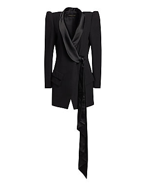 Image of A slouchy shawl collar extends into a swinging scarf tie on this tuxedo blazer mini dress. Voluminous puff sleeves add drama to the silhouette. Shawl collar Long sleeves Self-tie at front Waist flap pockets Lined Wool/acetate/viscose Dry clean Made in Ita