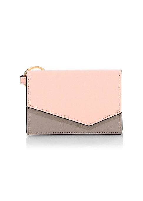 "Image of Crosshatch leather clutch with bold colorblock panels. Magnetic flap closure. Interior slip pocket.4.5"" x 3"" x 1"".Leather. Imported."
