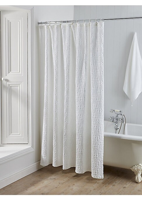 Image of From the Arlington Collection. This cotton shower curtain will bring a touch of spa-like elegance to your home with its intricate matelasse jacquard detailing in crisp white. Cotton. Machine wash. Imported.