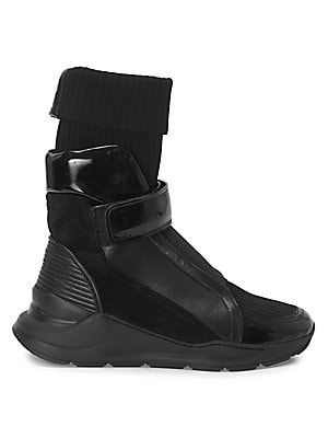 Image of Modern leather high-tops with a ribbed sock design. Textile/leather upper Front grip tape strap Round toe Leather/textile lining Rubber sole Spot clean Made in Italy. Men's Shoes - Designer Shoes. Balmain. Color: Black. Size: 42 (9).