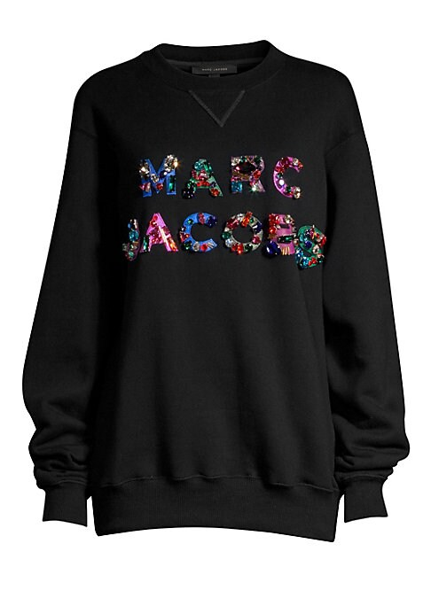 Image of A slouchy oversized sweatshirt that dazzles with patch and jeweled embellishments. Crafted from 100% cotton, this soft pullover pairs easily with a pair of trousers and sandals for a street-chic look. Crewneck. Long sleeves. Cotton. Hand wash. Imported. S