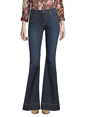 """Image of Bold flares add drama to mid-rise jeans Belt loops Zip fly with button closure Five-pocket style Rise, about 9.5"""" Inseam, about 35"""" Leg opening, about 25"""" Cotton/polyester/elastane Machine wash Made in USA of imported fabric Model shown is 5'10"""" (177cm) w"""