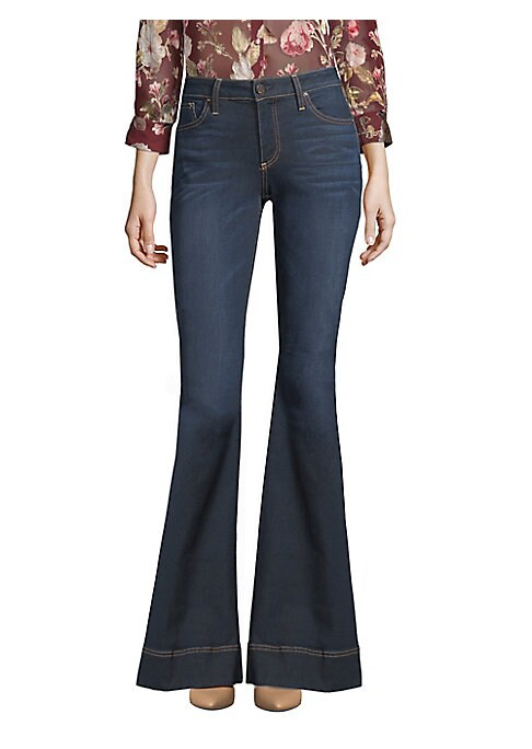 """Image of Bold flares add drama to mid-rise jeans. Belt loops. Zip fly with button closure. Five-pocket style. Rise, about 9.5"""".Inseam, about 35"""".Leg opening, about 25"""".Cotton/polyester/elastane. Machine wash. Made in USA of imported fabric. Model shown is 5'10"""" (1"""